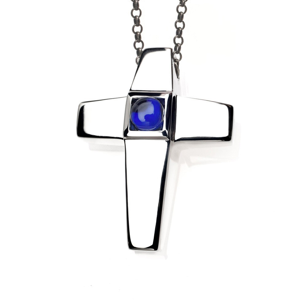 As shown, Treasured Memories® Cross Pendant with Simulated Sapphire Birthstone designed to match the End Caps of our Keepsake Bracelets, Pendants and Earrings.